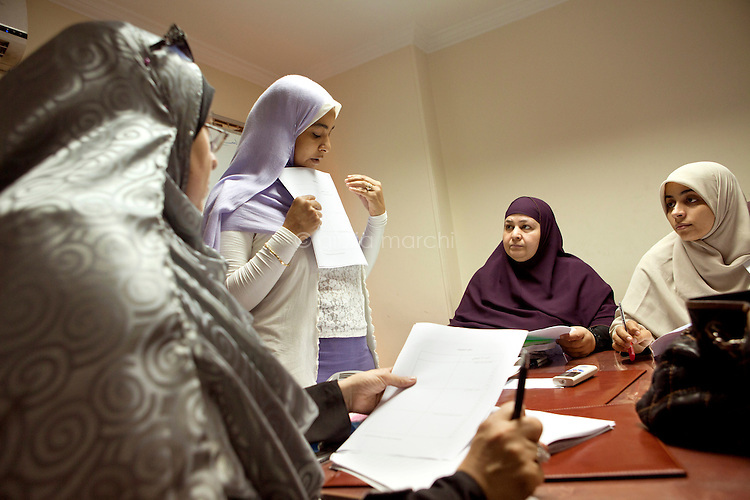 Abeer Olwan, a career development facilitator, gives a family lecture to women in the Freedom and Justice Party headquarters in Giza, Cairo. Egypt, October 2012.
