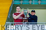 Causeway captain Muris Delaney accepts the  Division 1 County Hurling League Cup from Paidi Dineen (Hurling Officer Kerry GAA) after defeating St Brendans on Sunday.