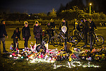 © Joel Goodman - 07973 332324 . No syndication permitted . 28/11/2013 . Bolton Road , Salford , UK . Young friends of 18-year-old moped crash victim , Tom Ackerley , who was killed in a crash last night (27th November 2013) , hold a candlelit vigil at the scene of the crash , this evening (28th November 2013) . Tom Ackerley was killed when riding his moped , in a crash involving a taxi and a Vauxhall Astra , in Salford, Greater Manchester , last night (27th November 2013) . Photo credit : Joel Goodman