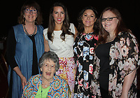NWA Democrat-Gazette/CARIN SCHOPPMEYER Kimberley Lane, Saving Grace alumna (from right), stands with Priscilla Backus, Courtney Thornton Smith, Sharon Braswell and Corrine Hunter (seated) at the Butterflies and Blooms benefit April 20 at the John Q. Hammons Center in Rogers.