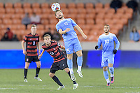 Houston, TX - Friday December 9, 2016: Cam Lindley (5) of the North Carolina Tar Heels heads the ball towards the Stanford Cardinal goal at the NCAA Men's Soccer Semifinals at BBVA Compass Stadium in Houston Texas.