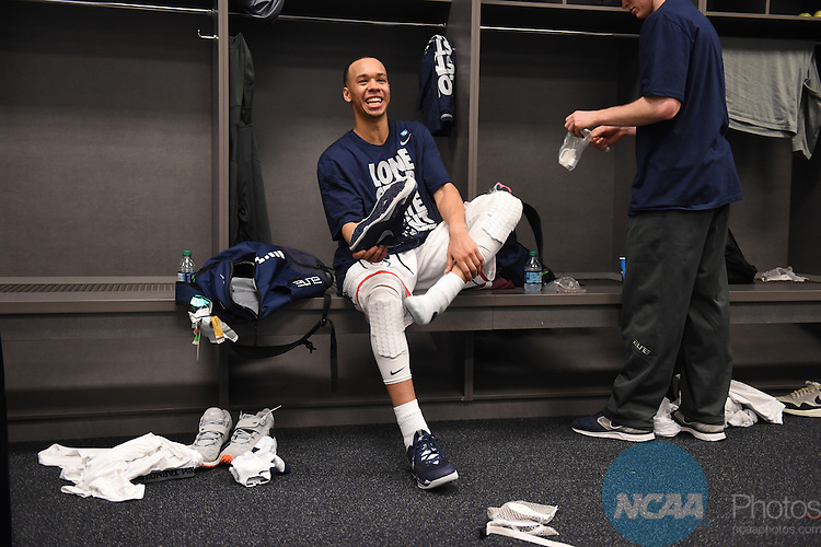 07 April 2014: Shabazz Napier (13) of the University of Connecticut is all smiles in the locker room after defeating the University of Kentucky during the 2014 NCAA Men's DI Basketball Final Four Championship at AT&T Stadium in Arlington, TX. Connecticut defeated Kentucky 60-54 to win the national title. Peter Lockley/NCAA Photos