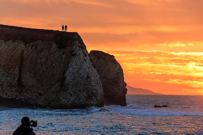 People enjoying a winter sunrise at Freshwater Bay, Isle of Wight