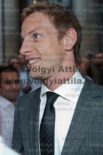 McLaren Formula One driver Jenson Button of Britain is surrounded by fans and journalists during the annual Hugo Boss party just prior to the Hungarian F1 Grand Prix in Budapest, Hungary. Thursday, 28. July 2011. ATTILA VOLGYI