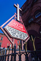 The ATLAH World Missionary Church on Lenox Avenue in Harlem in New York is seen on Friday, February 28, 2014.  The pastor of the church, James David Manning, uses the sign to show his displeasure with President Barack Obama, in this case by posting a homophobic message about white homosexuals stealing black men from black women under the auspices of Pres. Barack Obama. (© Richard B. Levine)