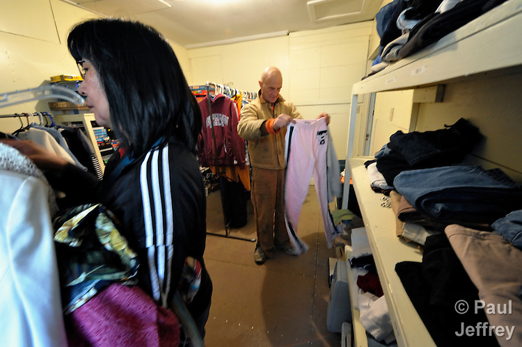 Igor Sudarkin examines clothing in the Thrift Shop, a project of United Methodist Women in Nome, Alaska. Sudarkin, a miner originally from Russia, is one of hundreds of new arrivals who've been lured to Nome by higher gold prices and a television reality show about mining in the Bering Sea community. The Thrift Shop is also supported by the Nome Community Center, a United Methodist Women-supported mission institution.