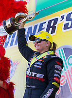 Apr 12, 2015; Las Vegas, NV, USA; NHRA pro stock driver Erica Enders-Stevens celebrates after winning the Summitracing.com Nationals at The Strip at Las Vegas Motor Speedway. Mandatory Credit: Mark J. Rebilas-