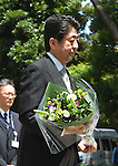 August 15, 2014, Tokyo, Japan - Japan's Prime Minister Shinzo Abe in ceremonial attire offers flowers to the war dead as he visits Chidorigafuchi National Cemetery in Tokyo on Friday, August 15, 2014, as Japan observes the 69th anniversary of the nation's surrender in World War II. Abe opted not to visit the nearby Yasukuni Shrine as did senior government officials but sent a ritual offering instead. (Photo by Katsumi Kasahara/AFLO) AYF -mis-