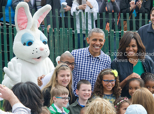 United States President Barack Obama and first lady Michelle Obama pose for photos as they greet participants as they host the 2016 White House Easter Egg Roll on the South Lawn of the White House in Washington, DC on Monday, March 28, 2016.<br /> Credit: Ron Sachs / CNP