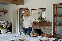 Carina Cooper in the kitchen/dining room of her Devon longhouse