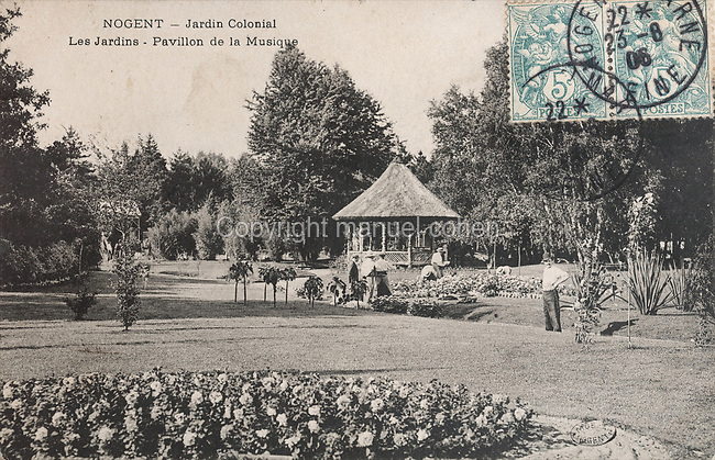 Gardens and the Kiosque de Musique behind, in the Jardin d'Agronomie Tropicale, or Garden of Tropical Agronomy, in the Bois de Vincennes in the 12th arrondissement of Paris, postcard from the nearby Musee de Nogent sur Marne, France. The garden was first established in 1899 to conduct agronomical experiments on plants of French colonies. In 1907 it was the site of the Colonial Exhibition and many pavilions were built or relocated here. The garden has since become neglected and many structures overgrown, damaged or destroyed, with most of the tropical vegetation disappeared. The site is listed as a historic monument. Picture by Manuel Cohen / Musee de Nogent sur Marne