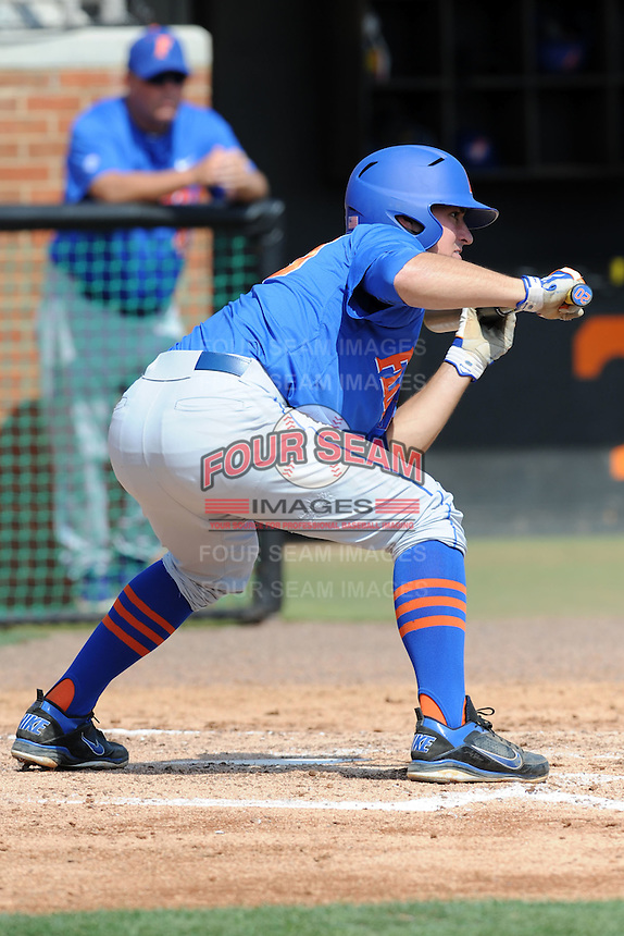 Florida Gators third baseman Cody Dent #20 squares to bunt during a game against the Tennessee Volunteers at Lindsey Nelson Stadium, Knoxville, Tennessee April 14, 2012. The Volunteers won the game 5-4  (Tony Farlow/Four Seam Images)..