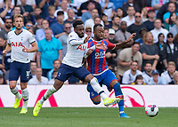 Danny Rose of Tottenham Hotspur battles with Jordan Ayew of Crystal Palace during the Premier League match between Tottenham Hotspur and Crystal Palace at Wembley Stadium, London, England on 14 September 2019. Photo by Vince  Mignott / PRiME Media Images.