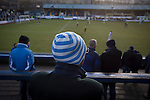 Home supporters in the Shed watching as Greenock Morton (in hoops) take on Stranraer in a Scottish League One match at Cappielow Park, Greenock. The match was between the top two teams in Scotland's third tier, with Morton winning by two goals to nil. The attendance was 1,921, above average for Morton's games during the 2014-15 season so far.