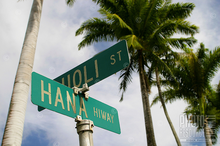 "Your sign post up ahead reads """"The Hana Highway"""". Here the road sign indicates your on the most scenic route on the island of Maui."
