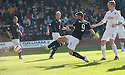 Dundee's Peter MacDonald scores their first goal.