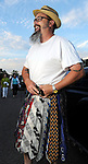 Big Al puts on his tie kilt at the 2010 Art Car Ball at the Orange Show Monument & Warehouse Thursday May 06,2010.  (Dave Rossman Photo)