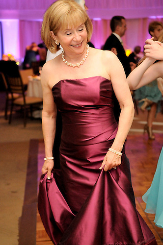 Wedding guests dance at Diana and Peter's elegant, fun wedding at Sleepy Hollow Country Club