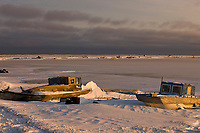 Boats along the shores of Barter Island in the village of Kaktovik, Alaska.