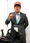 "November 21, 2017, Tokyo, Japan - Japanese robot creator Wataru Yoshizaki of Asratec displays the transformable robot ""J-deite Quarter"" which can change its shape of a robot to a vehicle at the ""Softbank Robot World 2017"" in Tokyo on Tuesday, November 21, 2017. Softbank's subsidiary Asratec and Brave Robotics have plan to launch a 4m tall transformable human ride robot ""J-deite RIDE"".     (Photo by Yoshio Tsunoda/AFLO) LWX -ytd-"