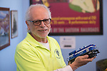 Farmingdale, New York, USA. November 26, 2016.  BAKE TURNER, of Melville, holds a blue Electromotivee Division EMD model train engine at the Train Masters of Babylon TMB Model Train Club's Open House. Visitors enjoyed a 4000 square foot O Gauge model railroad with 10 trains running on 19 scale miles of track and an underground subway system. Watching O Scale model trains traveling on tracks through various elaborate scenes was family fun, free and open to the public, during the long Thanksgiving holiday weekend.