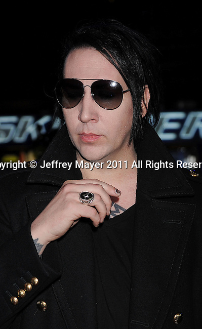 "UNIVERSAL CITY, CA - OCTOBER 10: Marilyn Manson  arrives to ""The Thing"" Los Angeles Premiere at AMC Universal City Walk on October 10, 2011 in Universal City, California."