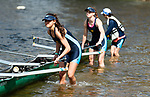 MIDDLEBURY,  CT-051519JS08-Westover crew members Maddie-Claire Norris, Gabby Young and Bella Chan, put their shell in the water as they prepare for their first ever home crew meet on Lake Quassapaug in Middlebury on Wednesday against the Forman School of Litchfield and the Kent School. <br /> Jim Shannon Republican American