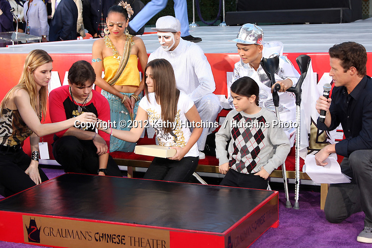 LOS ANGELES - JAN 26:  Prince Michael Jackson, Paris Jackson, Prince Michael Jackson, II aka Blanket;  at the Michael Jackson Immortalized  Handprint and Footprint Ceremony at Graumans Chinese Theater on January 26, 2012 in Los Angeles, CA