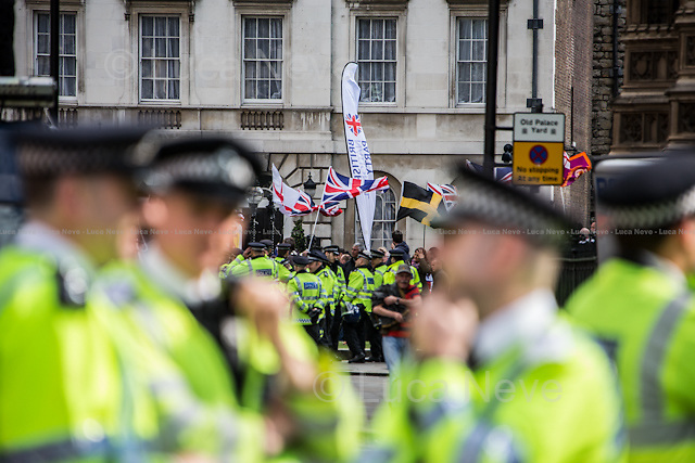 London, 01/06/2013. UAF (United Against Fascism) held a demonstration outside the Parliament to stop the BNP (British National Party) march. The aim of the far right political party rally was to lay a wreath at the Cenotaph in honour of the soldier Drummer Lee Rigby, victim of the Woolwich attack. The police in riot gears arrested 58 member of UAF under Section 14 of the public order act (1986).