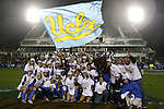 08 December 2013: UCLA players and coaches pose with the championship trophy. The Florida State University Seminoles played the University of California Los Angeles Bruins at WakeMed Stadium in Cary, North Carolina in a 2013 NCAA Division I Women's College Cup championship game. UCLA won the game 1-0 in overtime.