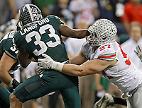Ohio State Buckeyes defensive lineman Joey Bosa (97) tackles Michigan State Spartans running back Jeremy Langford (33) in the 2nd quarter during the Big 10 Championship game at Lucas Oil Stadium in Indianapolis, Ind on December 7, 2013.  (Dispatch photo by Kyle Robertson)