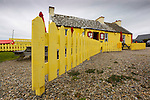 A yellow picket fence at a restaurant near The Cliffs of Moher in County Clare, Ireland on Friday June 21st 2013. (Photo by Brian Garfinkel)