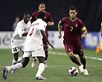 08 July 2007: Portugal's Bruno Gama (7) looks to dribble past Gambia's Alagie Ngum (4) and Sainey Nyassi (14). Gambia's Under-20 Men's National Team defeated Portugal's Under-20 Men's National Team 2-1 in a Group C opening round match at Olympic Stadium in Montreal, Quebec, Canada during the FIFA U-20 World Cup Canada 2007 tournament.