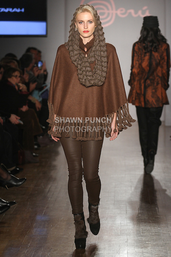 Model walks runway in an outfit from the Anntarah collection from Art Atlas, during the Peru Moda New York 2014 fashion show, at the Peru Expo.