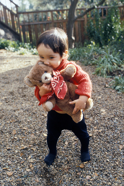 Berkeley CA One-year-old boy clinging to his favorite bear MR