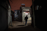 A chinese man walk the Hutong in Dongsi area, Beijing.