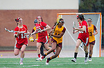 Los Angeles, CA 02/28/14 - Tierney Larson (Marist #12), Drew Jackson (USC #14) and Anna Petrunich (Marist #20) in action during the Marist Red Foxes vs University of Southern California Trojans NCAA Women's lacrosse game at Loker Track Stadium on the USC Campus.  Marist defeated USC 12-10.