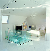 The large glass bath in the sleeping area of the penthouse was designed by Harvey West