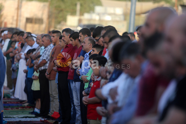 Palestinian muslims pray on the first day of of Eid al-Adha or the feast of sacrifice, in the West Bank City of Ramallah on September 24, 2015. Muslims across the world are celebrating the annual festival of Eid al-Adha, or the Festival of Sacrifice, which marks the end of the Hajj pilgrimage to Mecca and in commemoration of Prophet Abraham's readiness to sacrifice his son to show obedience to God. Photo by Shadi Hatem