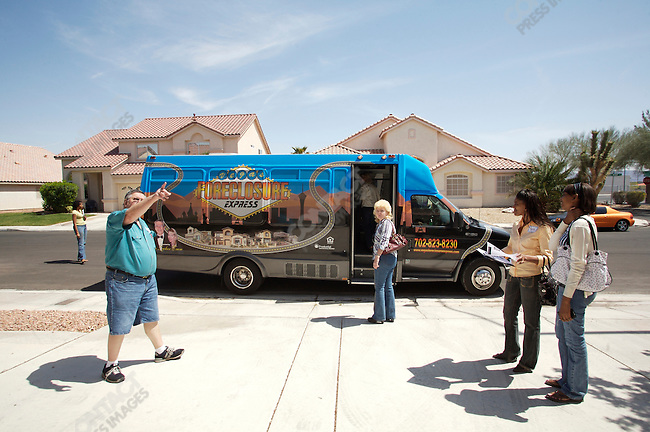 """Foreclosure Express"" bus tour operated by real estate agent Marshall Zucker show prospective buyers houses that have been foreclosed by banks due to the financial crisis. Buyers are mostly looking for deals on second homes as investments. Las Vegas, Nevada, USA, April 5, 2008"