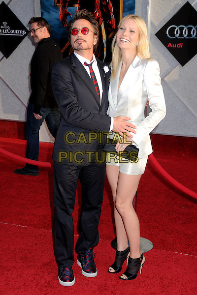 """ROBERT DOWNEY JR. & GWYNETH PALTROW .""""Iron Man 2"""" World Premiere held at the El Capitan Theatre, Hollywood, California , USA, .26th April 2010..arrivals full length shirt red striped tie suit tinted round hand clutch bag facial hair goatee beard  white silver shimmery shiny navy blue glasses sunglasses shorts trainers open toe shooboots ankle boots booties shoes .CAP/ADM/BP.©Byron Purvis/AdMedia/Capital Pictures."""
