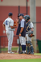 GCL Tigers West pitching coach Mike Alvarez  (center) talks with pitcher Liarvis Breto (43) and catcher Pedro Hurtado (7) during a Gulf Coast League game against the GCL Phillies West on July 27, 2019 at the Carpenter Complex in Clearwater, Florida.  (Mike Janes/Four Seam Images)