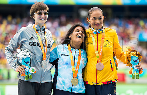 09.09.2016. Rio de Janeiro, Brazil.  Yanina Andrea Martinez (C) of Argentina, Claudia Nicoleitzik (L) of Germany and Martha Liliana Hernandez Florian (R) of Columbia celebrate their medals in the Women`s 100m -T36 - final during the Rio 2016 Paralympic Games, Rio de Janeiro, Brazil, 09 September 2016.