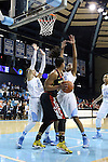 05 January 2014: Maryland's Alyssa Thomas (center) is defended by North Carolina's Jessica Washington (24) and N'Dea Bryant (right). The University of North Carolina Tar Heels played the University of Maryland Terrapins in an NCAA Division I women's basketball game at Carmichael Arena in Chapel Hill, North Carolina. Maryland won the game 79-70.