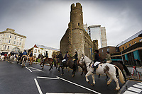 Pictured: The hunt travels past Swansea Castle. Thursday 26 December 2019<br /> Re: Guitarist Brian May of Queen has joined the Boxing Day Hunt in Wind Street, Swansea, Wales, UK.