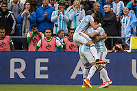 Seattle, WA - Tuesday June 14, 2016: Argentina defender Victor Cuesta (15) is embraced by his teammates after his goal during a Copa America Centenario Group D match between Argentina (ARG) and Bolivia (BOL) at CenturyLink Field