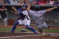 Tennessee Smokies catcher Luis Flores #7 attempts to tag out a hard sliding Joe Benson #5 during a game against the Jacksonville Suns at Smokies Park July 10, 2014 in Kodak, Tennessee. The Suns defeated the Smokies 6-5. (Tony Farlow/Four Seam Images)