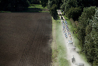 "Peloton riding the dusty gravel roads. <br /> <br /> Antwerp Port Epic 2018 (formerly ""Schaal Sels"")<br /> One Day Race: Antwerp > Antwerp (207km of which 32km are cobbles & 30km is gravel/off-road!)"