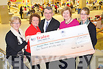 Derek Rusk Manager of the Manor West Shopping Centre presents a cheque for ?4,050 which were proceeds of their christmas crib to Recovery Haven Cancer Support, from left: Eileen Commerford, Philomena Stack, Derek Rusk, Maureen O'Brien and Siobhan McSweeney.