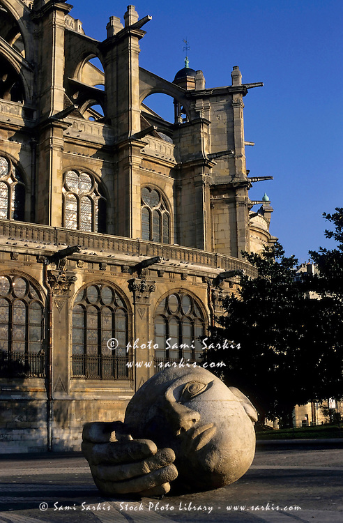 The l'Ecoute sculpture with Eglise Saint-Eustache in the background, Paris, France.
